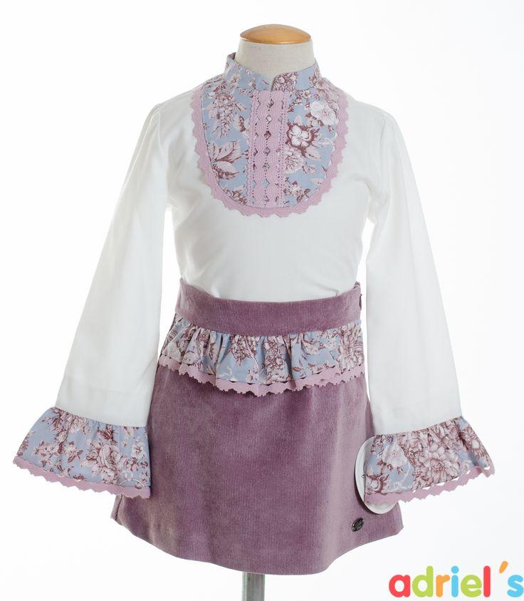 Conjunto de Dolce Petit para niña con falda y camisa.