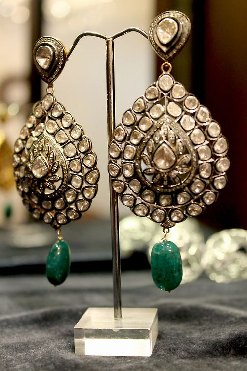 Gold and green earrings.