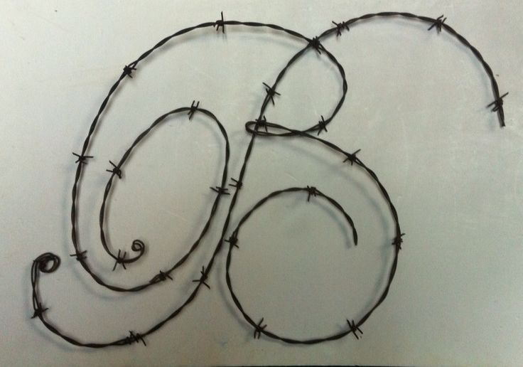 Everyone should have a barbed wire initial hanging on their wall!