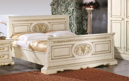 Bakokko classic wood bed with carved headboard and