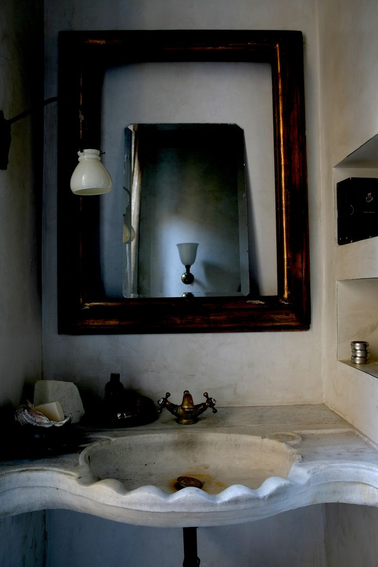 the bathroom detail of ancient marble basin private apartment after renovation milan