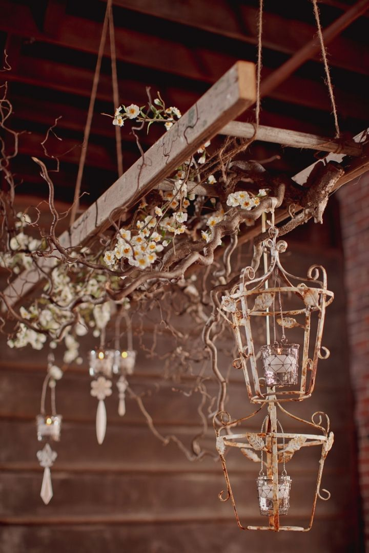 Ladder with driftwood and old lanterns chandelier wedding decor ideas