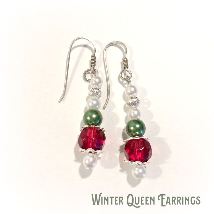 These beaded Winter Queen Earrings feature sterling silver ear wires with a beaded drop detail. Pearlised white beads are combined with red and green beads.