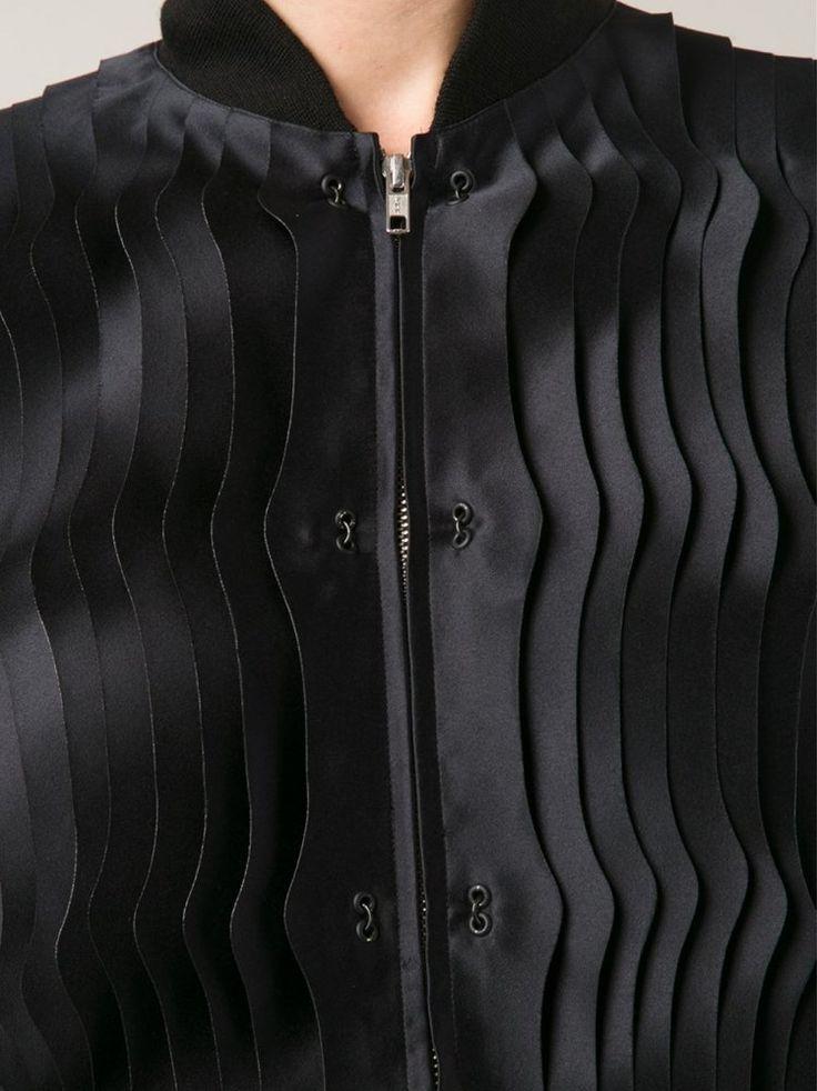 Black bomber jacket with wavy textures; fabric manipulation; sewing; creative fashion detail // Noir Kei Ninomiya