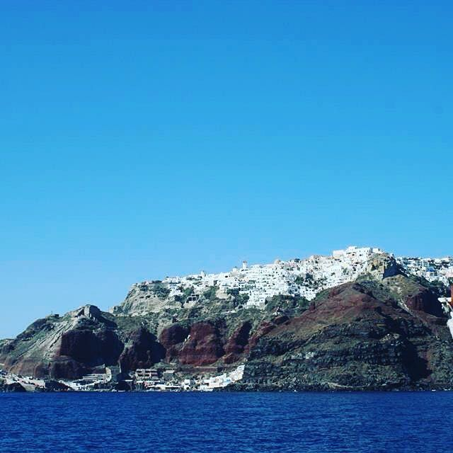 View of Santorini, in the Greek Islands, from the sea, I'm on a boat. Majestic. #santorini #greekislands #greek #traveltease #travel #instatravel #instago #travelling #tourism #holiday #imonaboat #ahoy #littlebitsick
