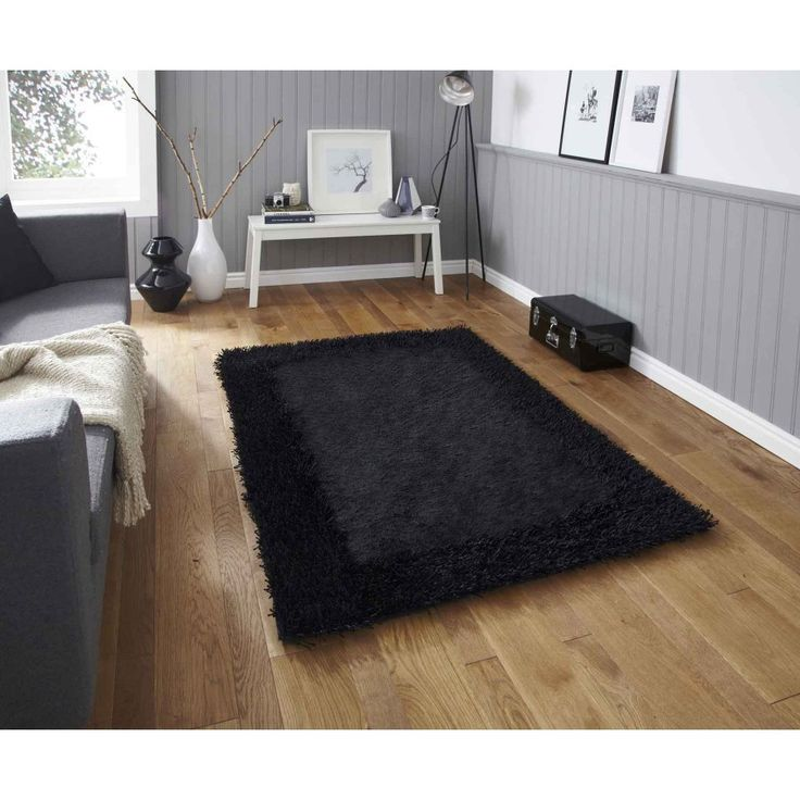 Explore the bold and the beautiful, Sable 2 Black Bordered Rug By Think Rugs. Black colour in dual tone finish combines to create a bordered pattern. #handmaderugs #plainrugs #borderedrugs #blackborderedrugs #shaggyrugs #blackshaggyrugs