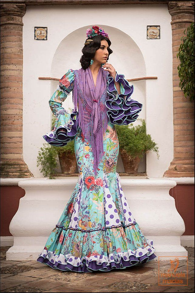 traje flamenca--nice combination of floral and polka dots. love the purple ruffles