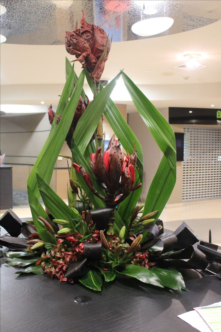 Large Corporate arrangement featuring Gymea flower and Red Lily. Created by Poppies and Peas Floral Design.