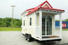 The Shonsie is a 206 sq.ft. cottage style tiny house available from 84 Lumber as a shell or move-in ready. A red epoxy floor provides a unique look.