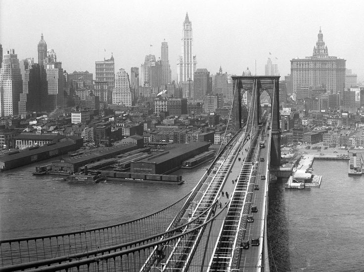 View of the New York City from the Brooklyn Tower of the Brooklyn Bridge, photographed by Eugene de Salignac, april 1933.