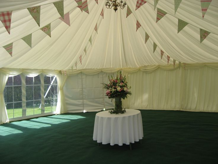 Bunting makes a pretty welcoming decoration in this reception marquee ready for guests to enjoy a glass of fizz.