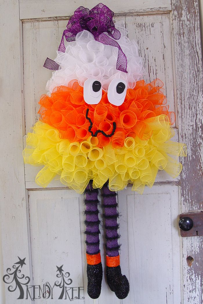 Candy Corn Wreath Tutorial - Video and written instructions, supply list.  Topped off with a bow.....face made of foam craft and Hanging Fabric Witch Legs   http://www.trendytree.com/blog/candy-corn-wreath-tutorial/