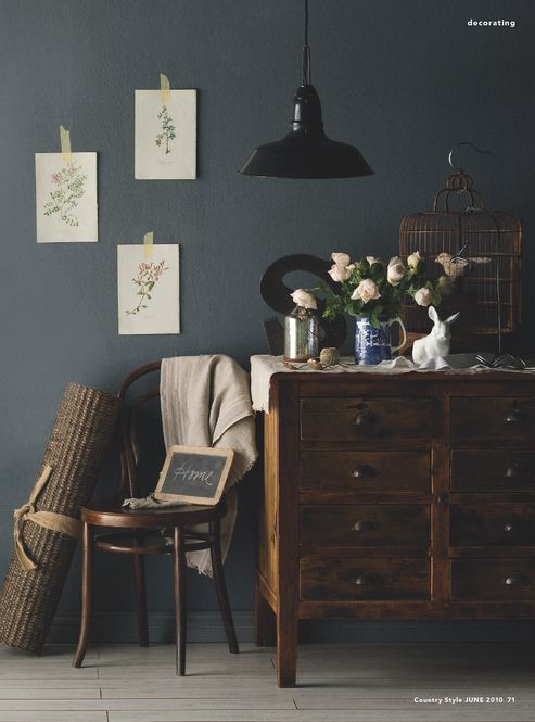 Bedroom colors someday... steel grey walls with dark wood and white: