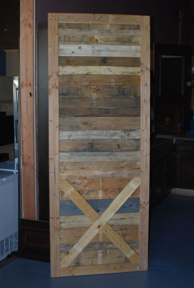 Rustic sliding barn door with x bracing out of reclaimed for Rustic sliding barn doors interior
