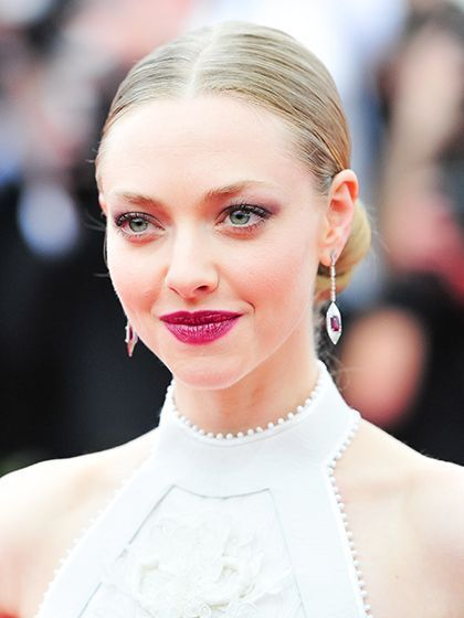 2015 Met Gala - Amanda Seyfried sleek middle-part updo with wine colored lipstick | allure.com