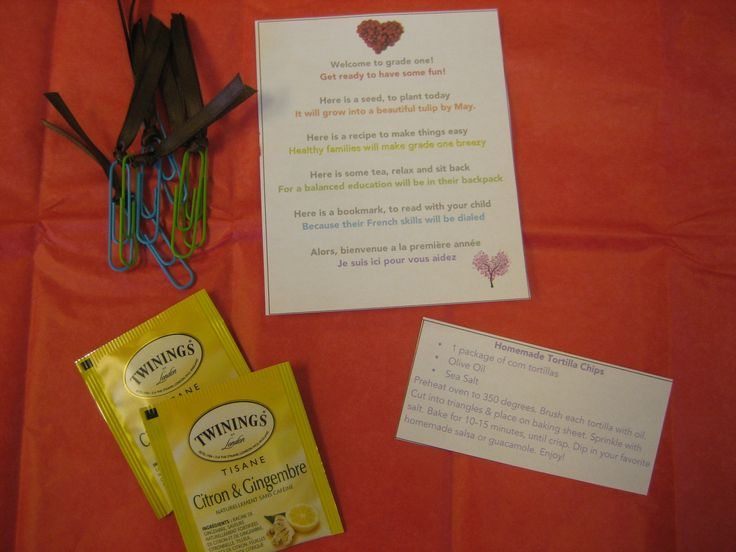 I wrapped all items in red tissue paper and tied with green (to look like an apple). There was a homemade bookmark, a recipe, tea and a tulip seed (not shown). All had a poem to go with it.
