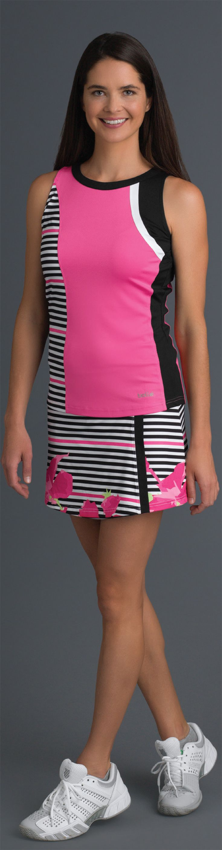 Check out Bolle's Verona women's tennis collection for spring 2018. This premier collection of women's tennis apparel includes tennis skirts, tops, and tanks in hibiscus pink, black, white and verona print fabric for the ideal update to your look for the season. Shop more Bolle tennis activewear at MidwestSports.com.