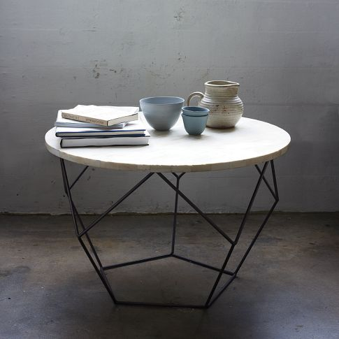 """Origami"" table from West Elm. You can't beat the price for such a chic table. It's a statement piece. Biddy Craft"