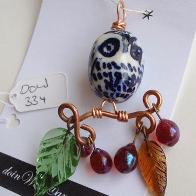 doinWire Pendant, ceramic owl, green and brown transparent leaves, burgundy beads, on curly copper branch. DOW334