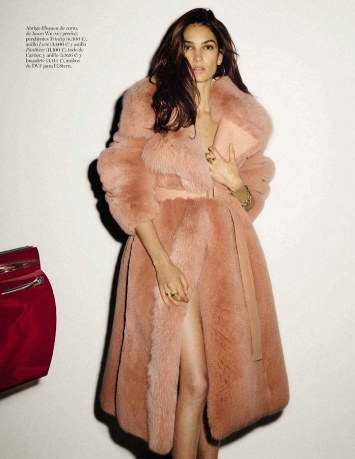 Lily Aldridge poses in blush colored coat for Vogue Spain Magazine January 2016