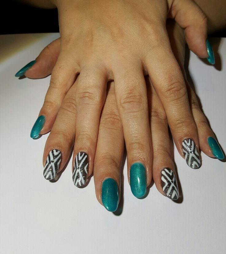 Gel nails done in Oval shape, Orly - It's up to blue, Goth, Kiss's Silver over top, Orly - White Tip for art details and rhinestones.
