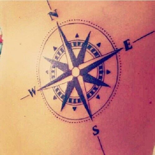 I like the idea of getting a compass tattoo also.  Maybe a red heart in center of compass with hubby's first initial in scripty writing.