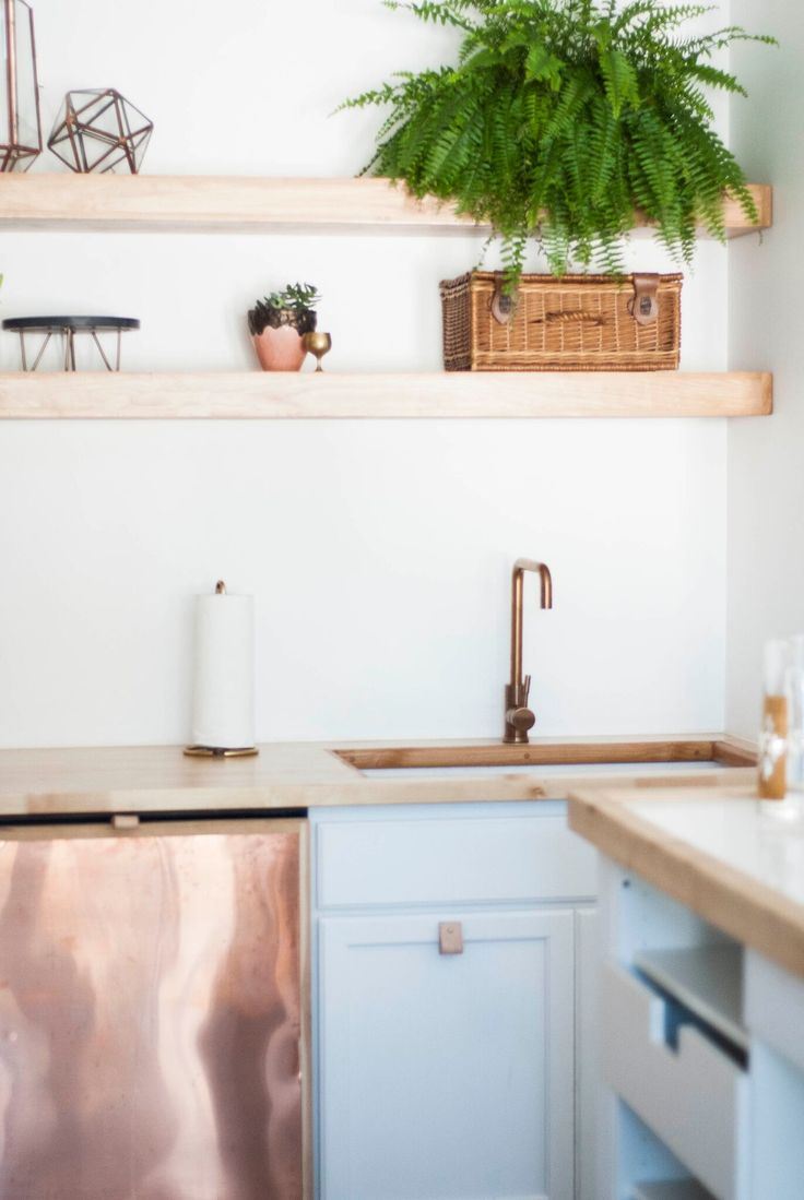 Gold and brass fixtures and faucets promising or passe apartment - Metal Copper Panel Dishwasher And Sink With A Rose Gold Faucet Via Birch Brass Vintage