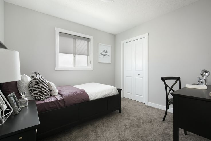 Secondary bedroom in Creations by Shane Homes Arbor Duplex Showhome in Legacy in southeast Calgary #bedroom