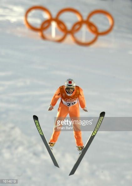 Nicolas Dessum of France competes in the first round of the men's K90 ski jumping event during the Salt Lake City Winter Olympic Games at the Utah...