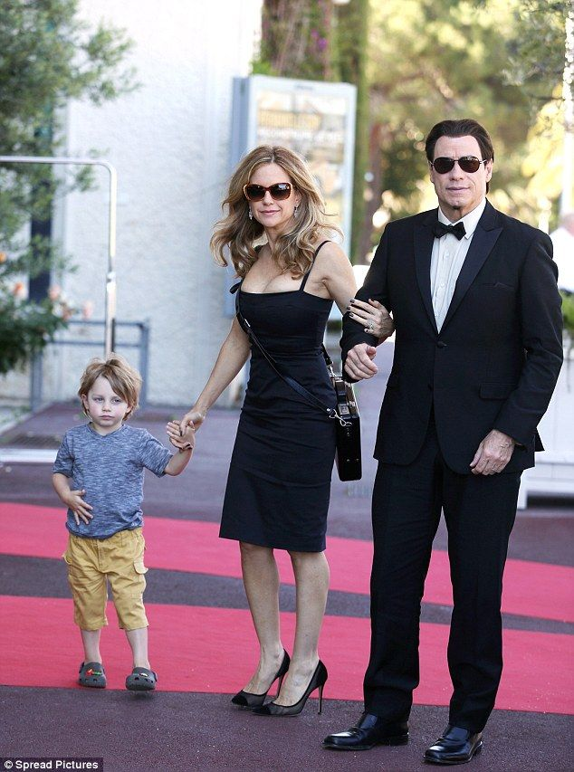 John Travolta and Kelly Preston escort son Benjamin aboard private jet