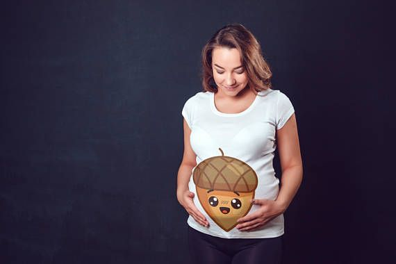 Cute Acorn T-Shirt - Funny Maternity Shirt - Women's Acorn Maternity Shirt - Gift For Moms To Be - Maternity & Pregnancy Tshirt Top Gift. For the mother-to-be, this maternity t-shirt affords the space you need to keep comfortable throughout your pregnancy. The snug fit and longer length allows you to maintain a slim appearance when compared to other shorter and bulkier maternity tees.
