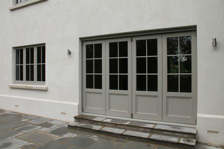 Wooden bifold doors painted Farrow & Ball Hardwick White