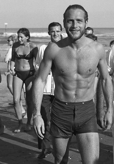 Paul Newman draws attention after emerging from the water at Lido Beach, Venice, in 1963.