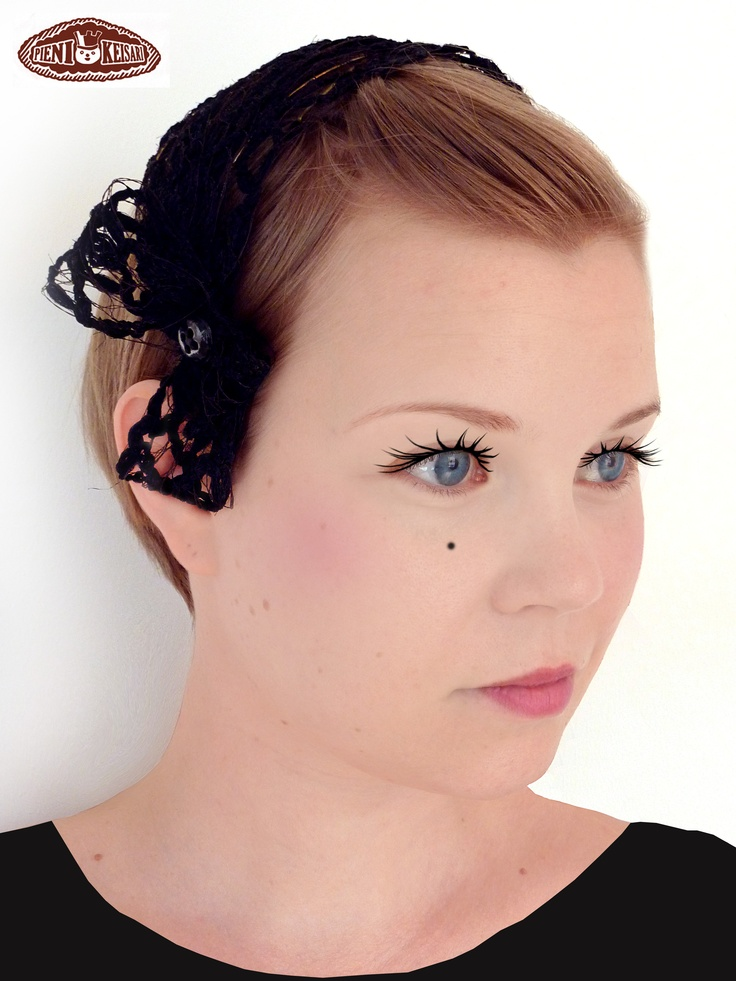 A black festive headband with a bow and a button detail  http://www.facebook.com/pages/pieni-keisari/79394388494