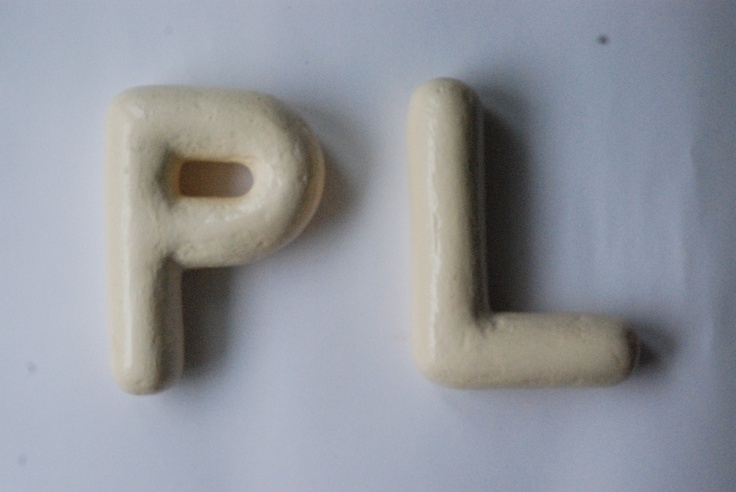 Front of two letters made out of papier mache. For a friend's house where there are two larders, and no-one can decide which is the pantry and which is the larder.