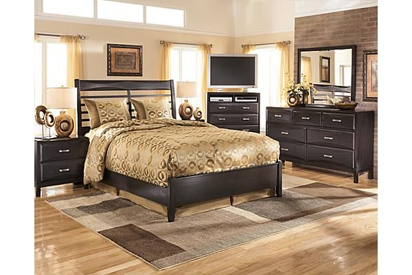 "The Kira Panel Bedroom Set from Ashley Furniture HomeStore (AFHS.com). With a dark finish and exciting contemporary design, the beauty and refreshing style of the ""Kira"" bedroom collection creates the perfect atmosphere for the bedroom of your dreams."