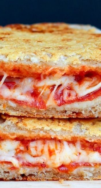 Grilled cheese was meant for the grill and this Parmesan Crusted Pepperoni Pizza Grilled Cheese should be proof of that.