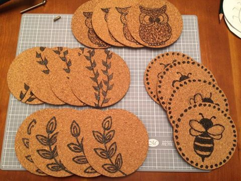 Cork coasters. Used a wood burning tool to burn the designs into it