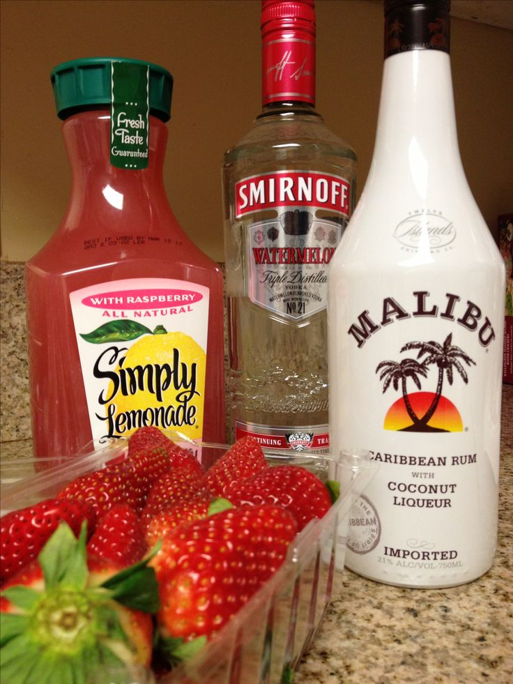 Sneaky beach cocktails! Mixed with watermelon Smirnoff vodka, Cocunut Malibu, simply rasberry lemonade & fresh strawberries.