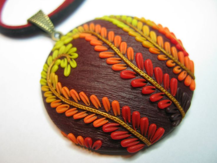 Awesome red, orange and yellow feather-like clay design pendant