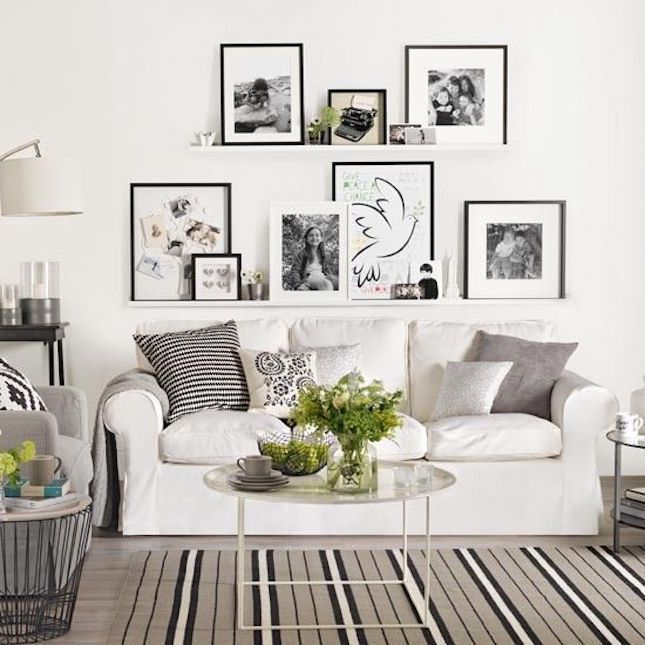 ledge shelves with art over sofa  ikea living room couch