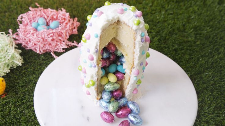 If guests aren't impressed by how this cake looks from the outside ('cause you know they are going to be!), just wait until you cut into it and oodles of Easter candies spill out.