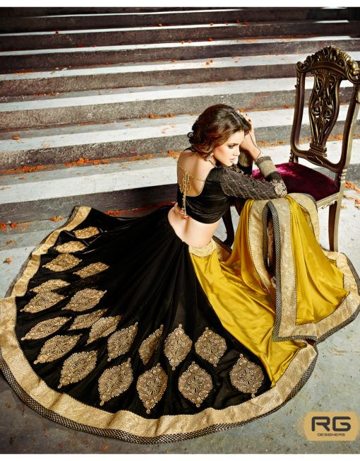 Green Black Saree || Look stunning in this black color Saree beautified with big heavy gold embroidered, zari, stone work buttas on bottom and border patch. || RG Designers