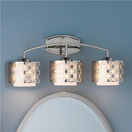 """Modern Wedding Rings Bath Light - 3 Light - Cutout floral grill over glass makes a modern statement with timeless appeal. Polished Nickel with satin white glass shades. (3x100 watts (medium base sockets). (11""""Hx25""""Wx8.5""""D) Product SKU: BS12029 PN Price: $189"""