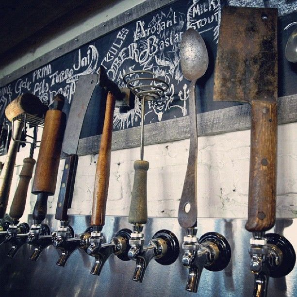 Incredible beer taps! I love rusty metal objects. I love the hand lettering on the chalkboard, too.