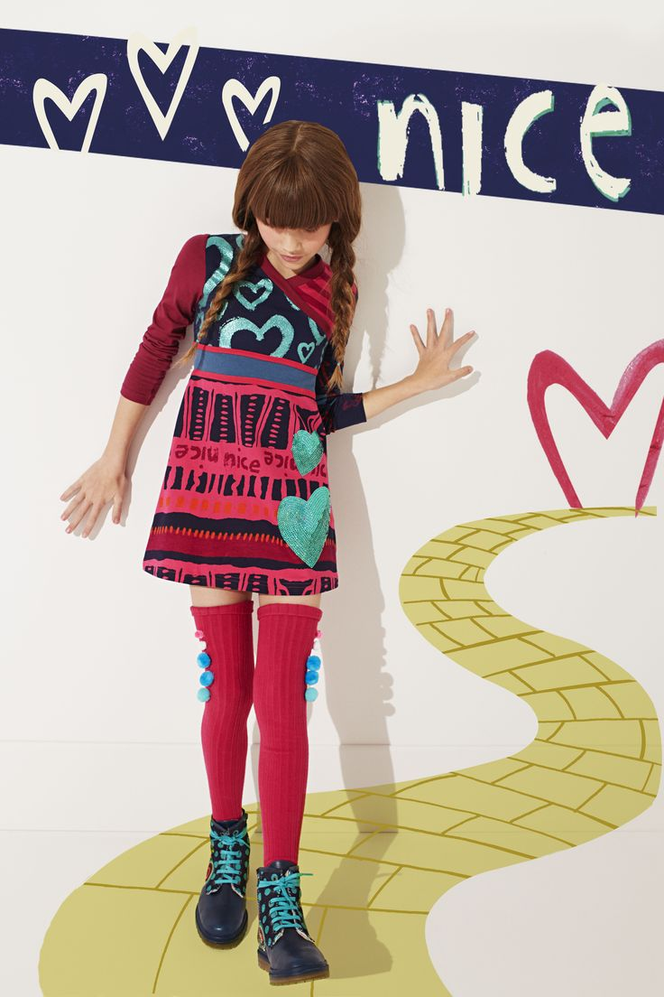The picture says it all really. This long sleeved, patterned dress is versatile, fun and....dare we say, NICE!