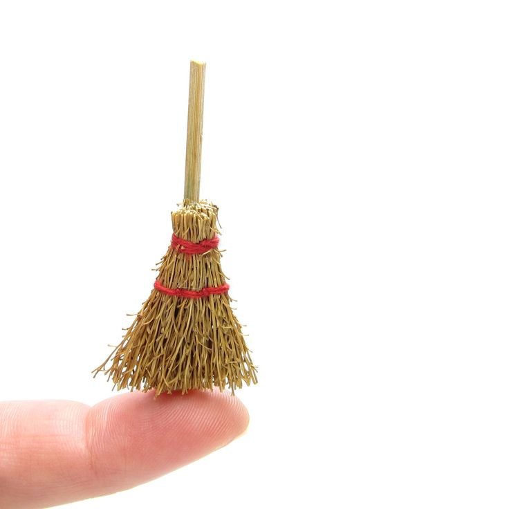 This miniature broom is made of natural colored straw tied with red string and is perfect for your dollhouse miniatures or craft projects. It's just the right size for 1-inch scale dollhouse miniature