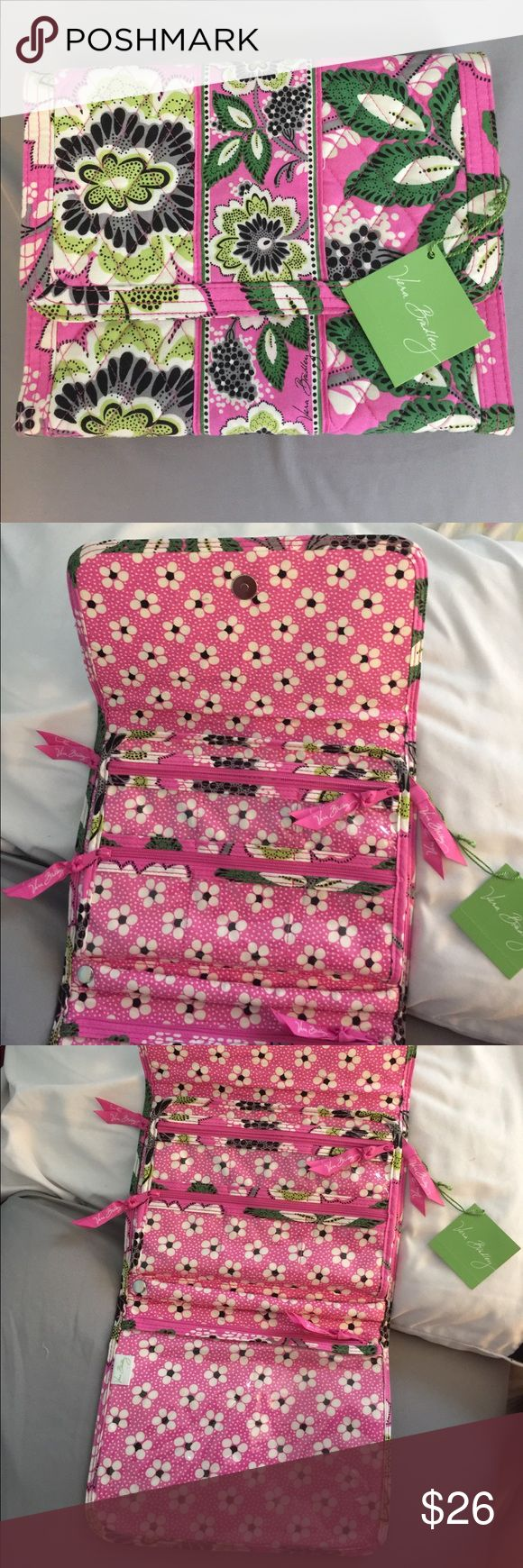 Vera Bradley Travel Bag Brand new travel bag! Pretty pink bag that allows you to travel organized and in style! It may be hard to tell in the pictures but there is a middle section that can be flapped back and forth. 11 different compartments! Vera Bradley Bags Travel Bags