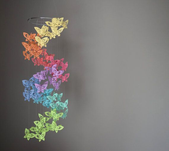 Rainbow butterfly mobile...I have a bunch of paint chip cards laying around, gonna try to make this for my kids' room.