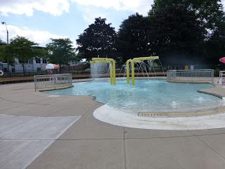 Artesani Park & Wading Pool-- on Soldiers Field Road.  Wading pool, water jets, and playgrounds.  Free parking and close to the city.  We love it.  In Brighton.